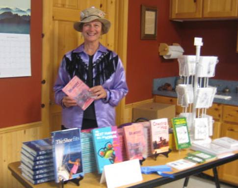 Author Rae Ellen Lee signing a copy of The Bluebird House.