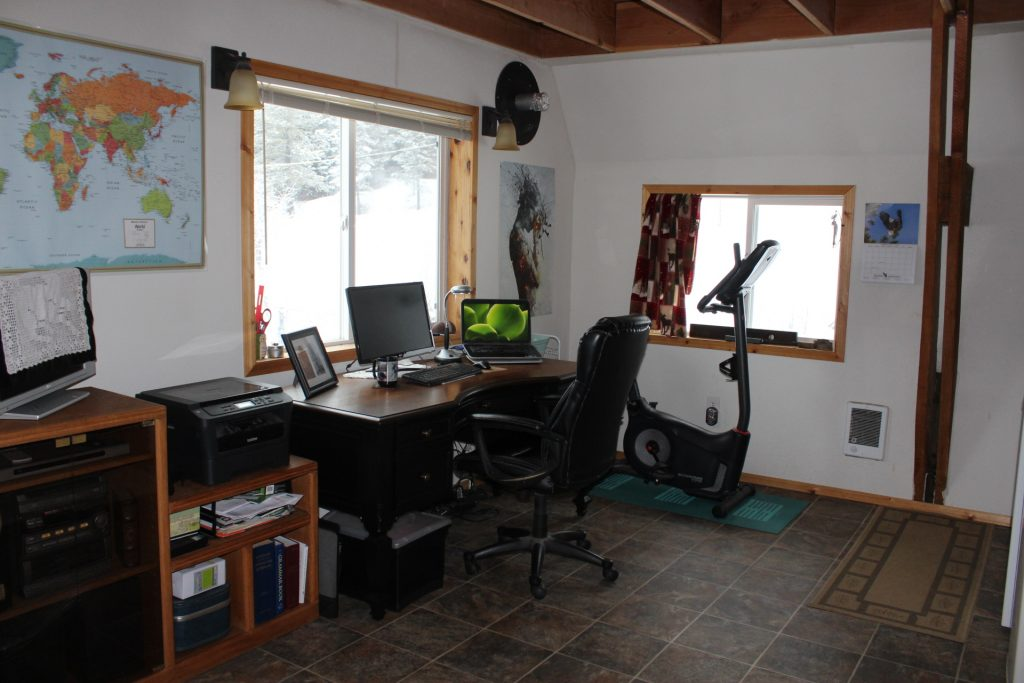 Photo of office area after the stove came out and furniture was rearranged.